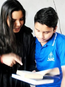 Shrishti working with a student