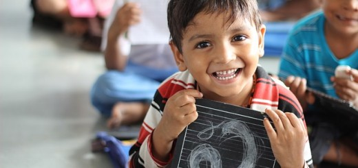 A boy having smiling in a classroom