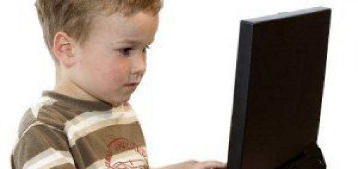 A boy using a laptop